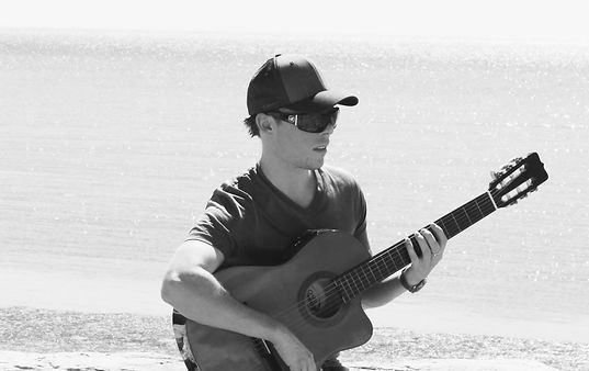 Brook George playing guitar