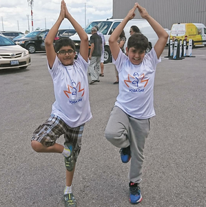 Children doing yoga before entering the complex