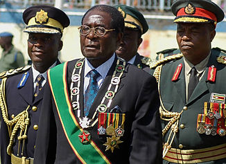 Mugabe flanked by generals Getty 2017 (1