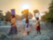 Zim women fetching water.jpg