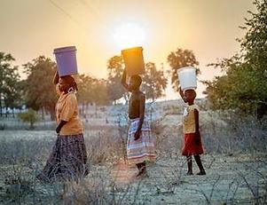 Zim women fetching water.jpg