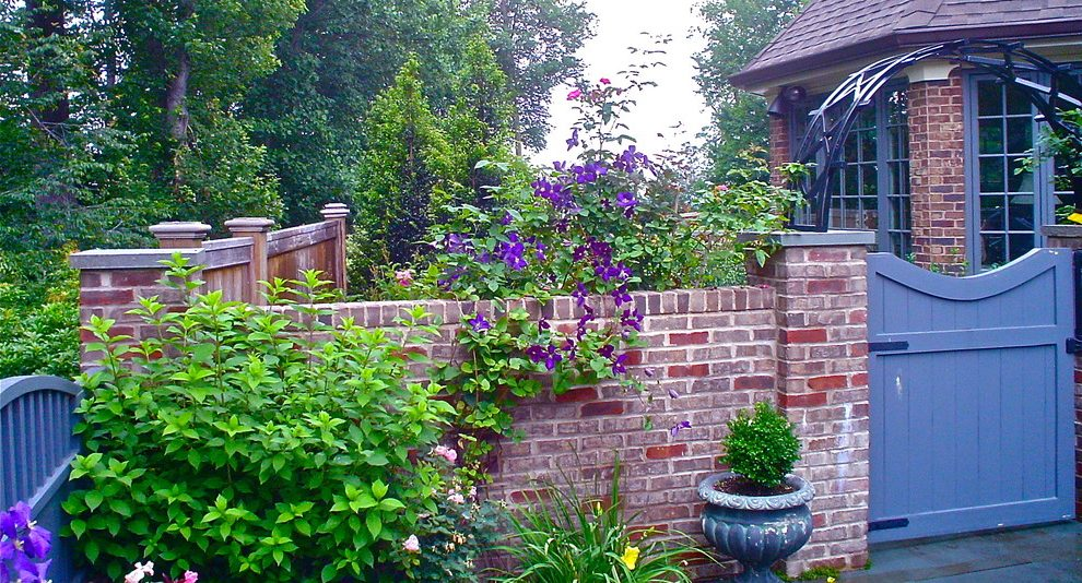 brick-garden-walls-landscape-eclectic-with-perennials-tiki-torches