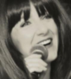 Closeup photo of Lori Joachim Fredrics with microphone