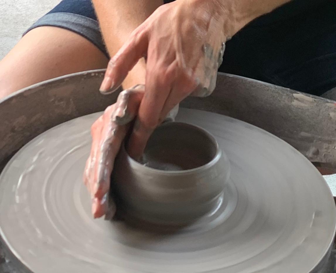 Pottery Pavilion - Adult Hands Close Up.