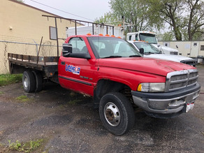 comaglia-red-cab-truck-with-flat-bedjpg