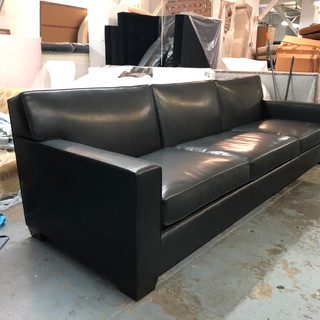Custom Jean Michel Frank sofa with a down back, perfectly upholstered in a black leather