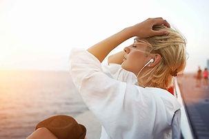 leisure-travel-girl-earbuds.jpg