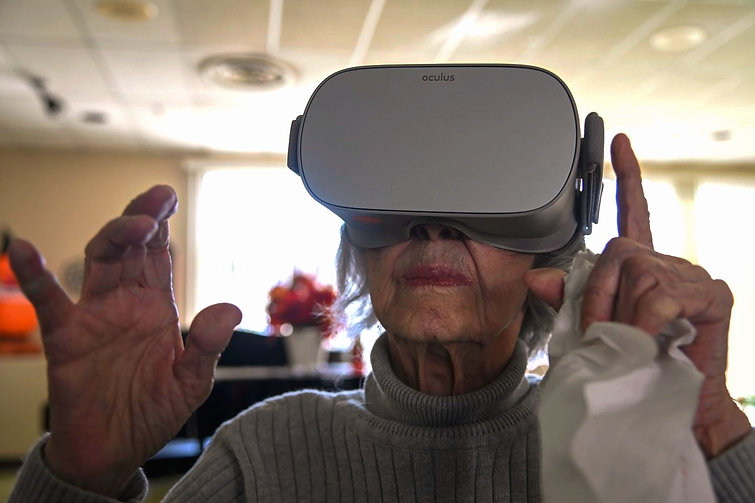 Resident with Viva Vita VR headset on