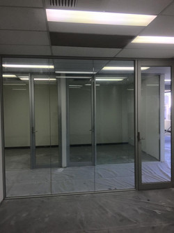 Toughened glass wall with hinge door