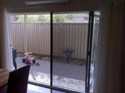 Retractable flyscreen on bi folds