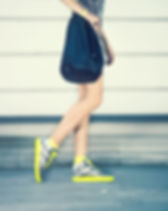 Girl with Yellow Sneakers
