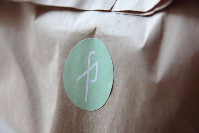 LOGO-STICKER ON GIFT BAG