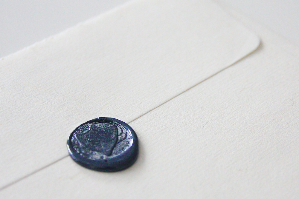 HANDMADE SEALS ON THE BACK OF EACH ENVELOPE