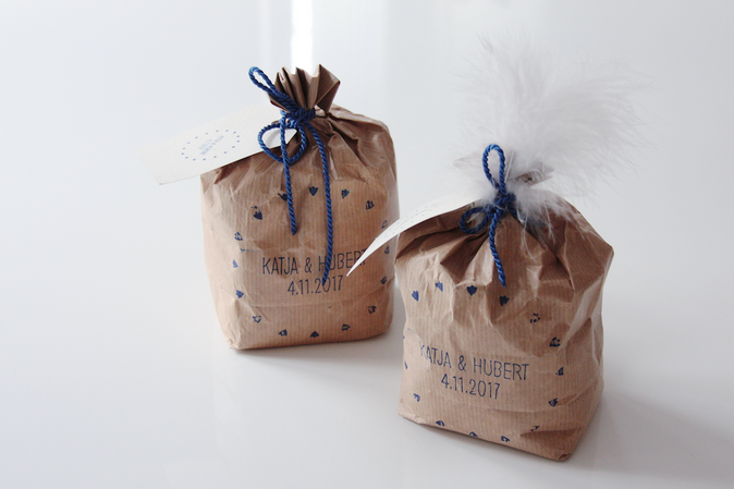 BAGS WITH FLOUR FORM THE ON-SITE MILL AS GIVE AWAYS