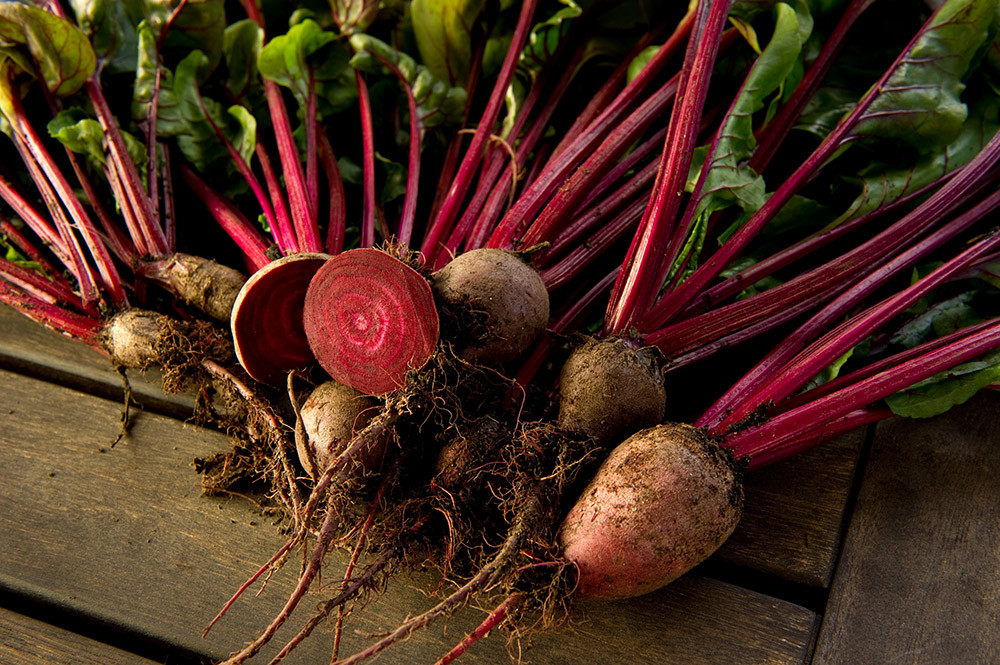 Beets just pulled out of the ground laying on top of each other