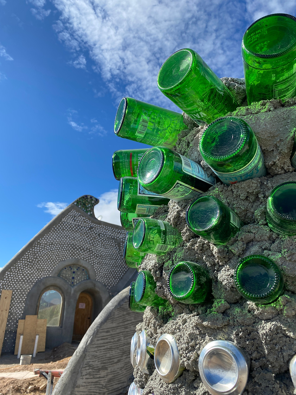 Earthship bottles and cans foundation - Image from eartshipbiotecture.com