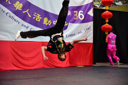 Wushu student flying and rotating through the air.