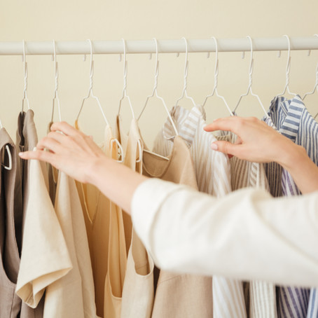 What are the benefits of having a stylist help clear your wardrobe?