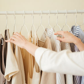 Orderly Clothes Hanging in closet