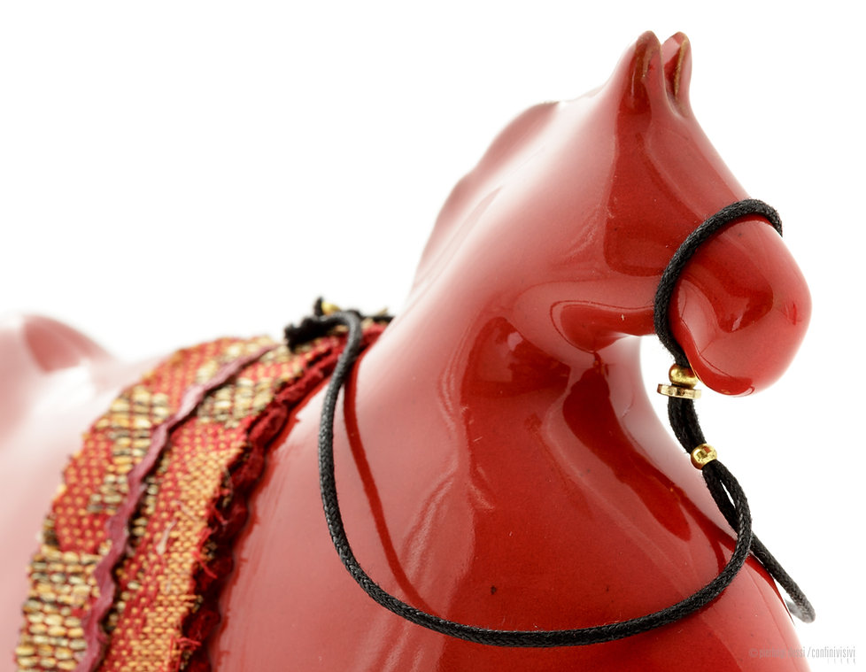cavallino a dondolo tondo cm.17.jpg