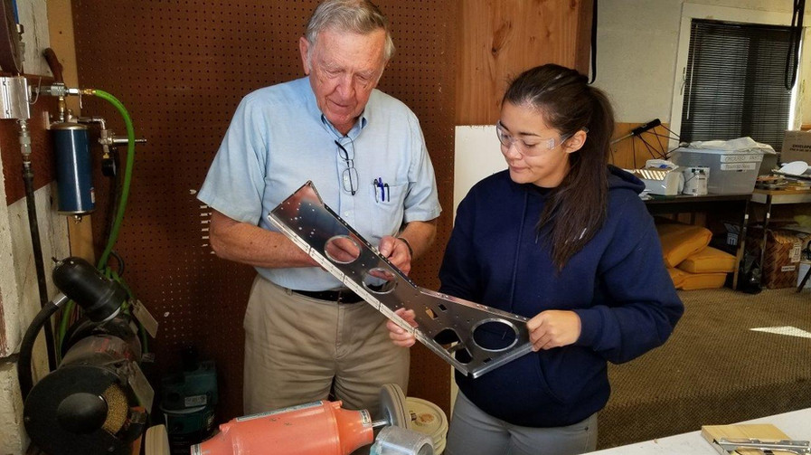 Dick VanGrunsven works with a TeenFlight student at our Hillsboro facility