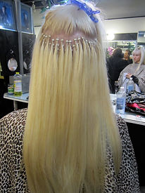 This is what microlink hair extensions look like during application process. Microbead extensions, microlink extensions, i-tip hair extensions.