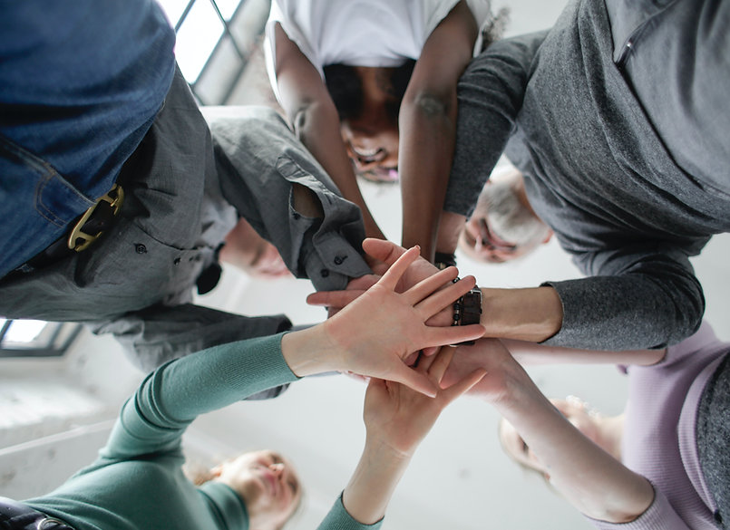 low-angle-photo-of-people-holding-hands-