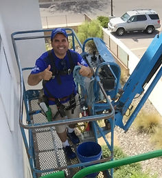 Owner Peter Cruz on an aerial lift demostrating safety.