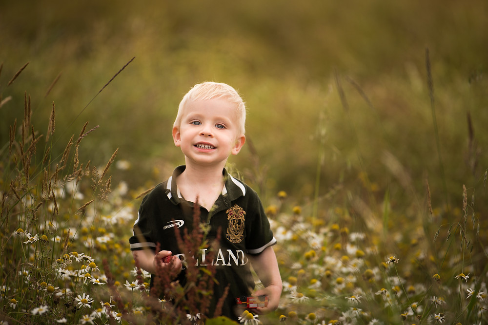 Best-aberdeen-family-children-photographer-montrose-arbroath-aberdeenshire-blonde-boy-standing-in-meadow-nikon-200mm