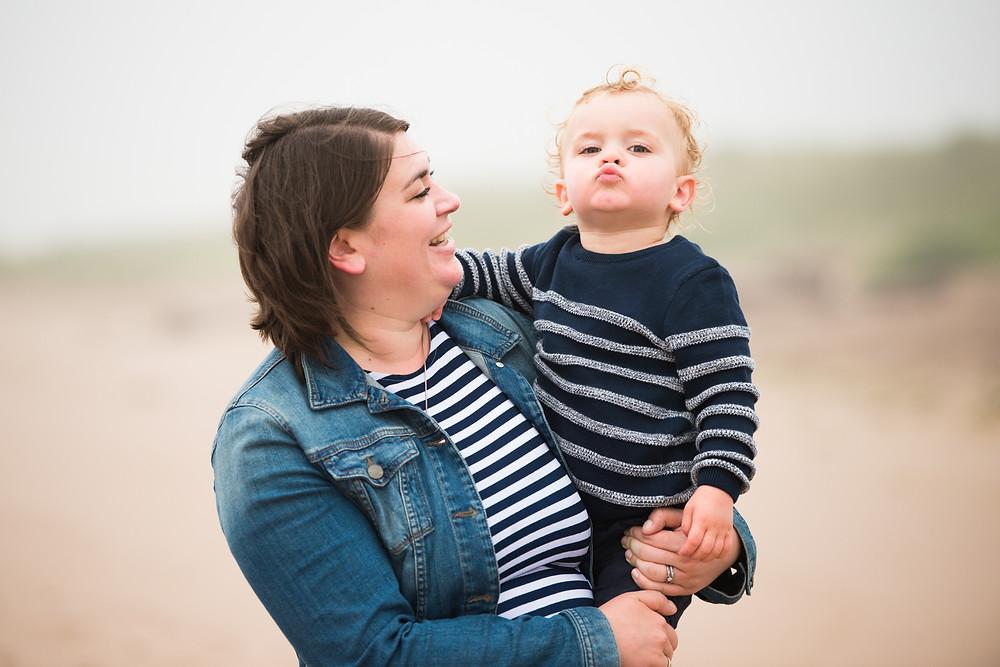 Best-aberdeen-family-children-photographer-montrose-arbroath-aberdeenshire-beach-st-cyrus-outdoors-natural-portrait-boy-pouting-into-camera