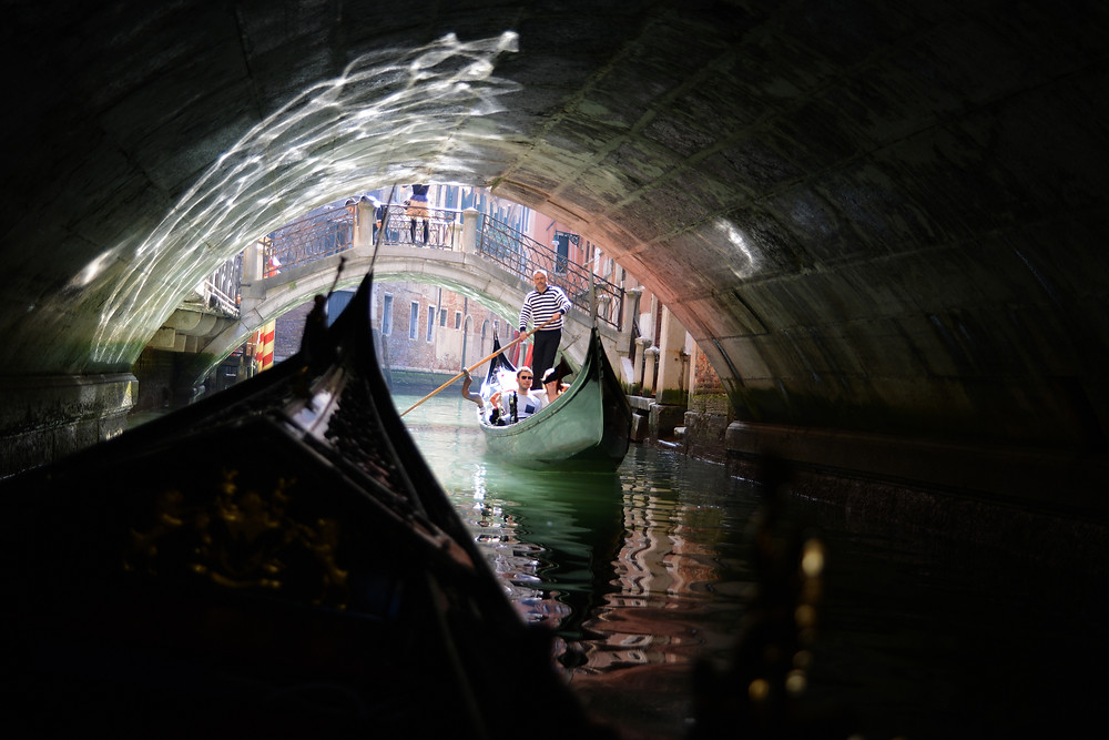 Gondola ride along a canal in Venice, Italy, travel photography