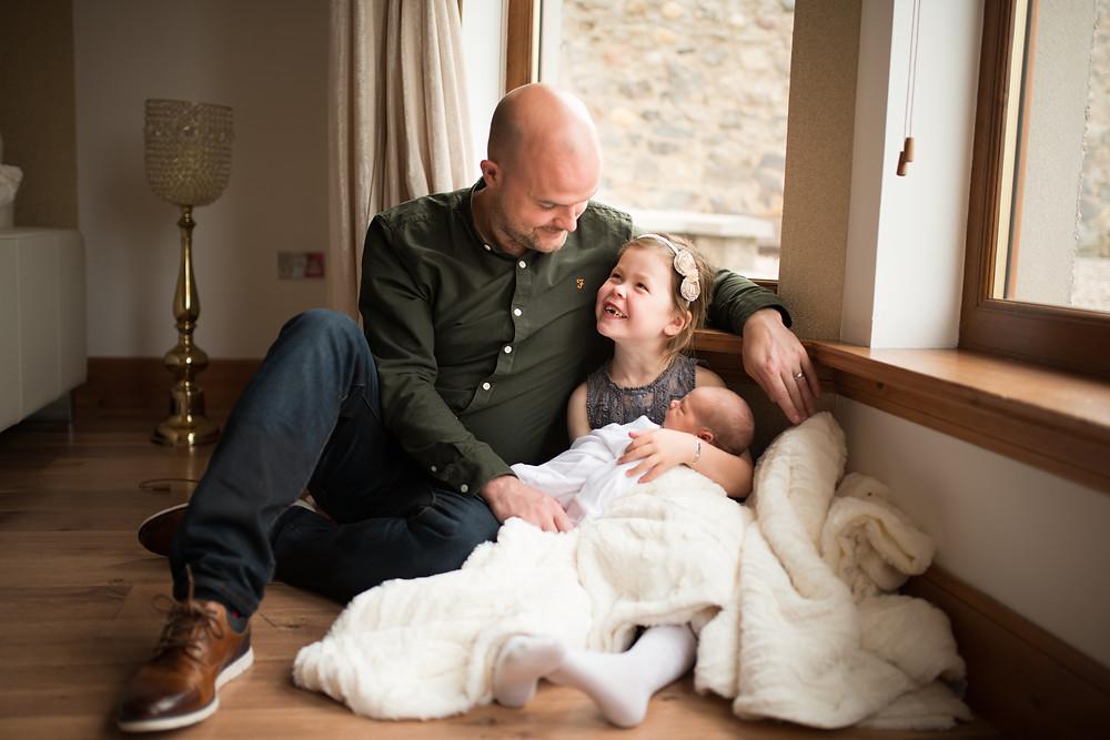 Best-aberdeen-family-children-photographer-montrose-arbroath-dad-and-daughter-cuddling-in-window-light-newborn-baby-boy-lifestyle-indoors