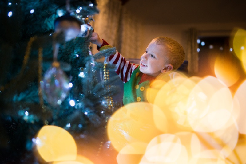 best-aberdeen-family-children-photographer-montrose-boy-decorating-christmas-tree-bokeh-indoor-lifestyle