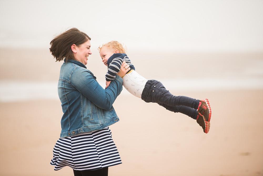 Best-aberdeen-family-children-photographer-montrose-arbroath-aberdeenshire-beach-st-cyrus-mom-twirling-with-boy