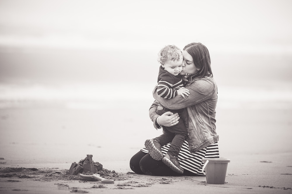 best-aberdeen-family-photographer-montrose-beach-saint-cyrus-mother-hugging-son-in-black-and-white