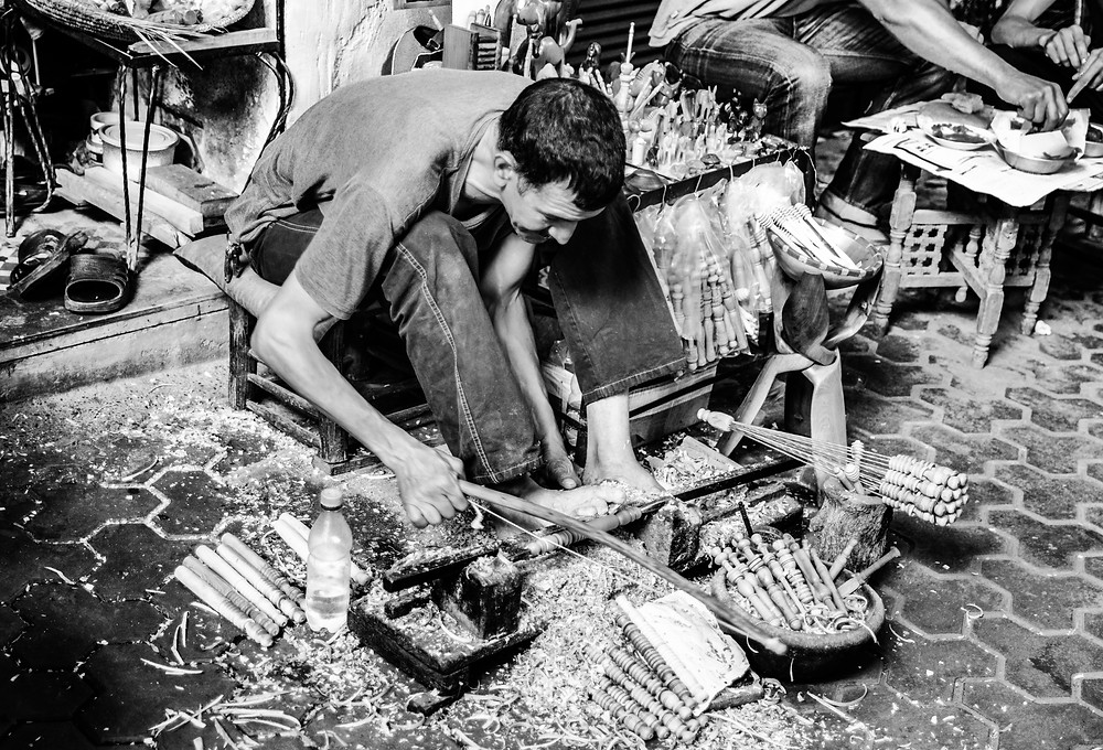 Wood work in a Marrakech souk in black and white, travel photography