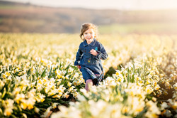girl-running-through-daffodil-fields-scottish-photography