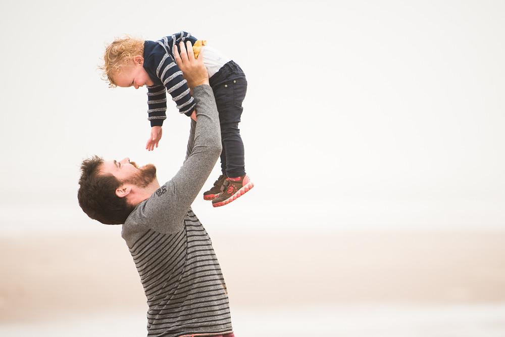 Best-aberdeen-family-children-photographer-montrose-arbroath-aberdeenshire-beach-st-cyrus-outdoors-dad-lifting-child-in-air