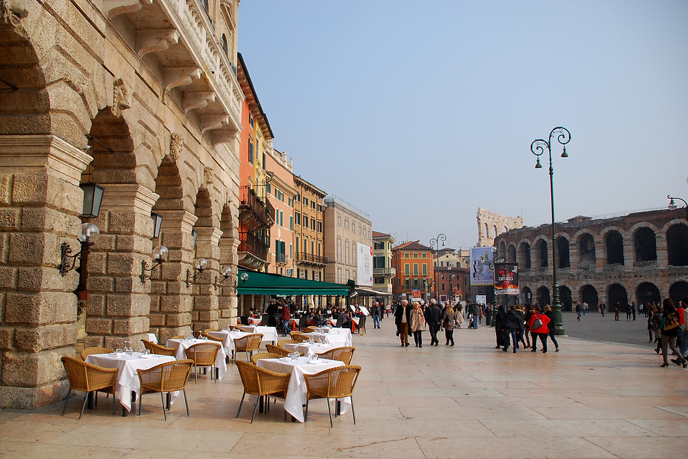 Verona, Italy, cafe tables in the piazza by the Coliseum