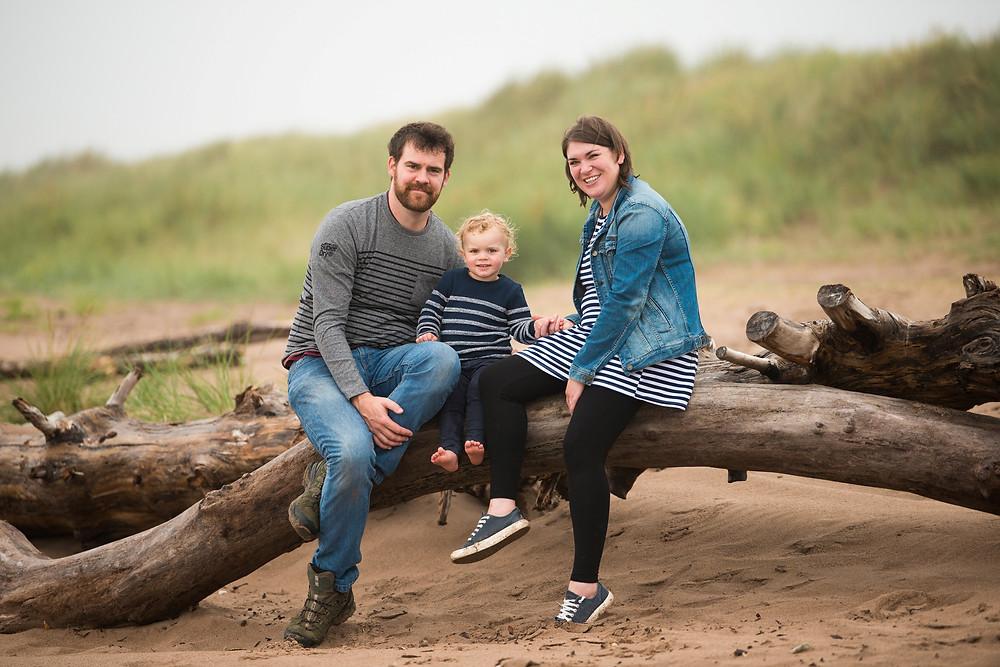 Best-aberdeen-family-children-photographer-montrose-arbroath-aberdeenshire-beach-st-cyrus-outdoor-natural-light-happy-family-on-driftwood