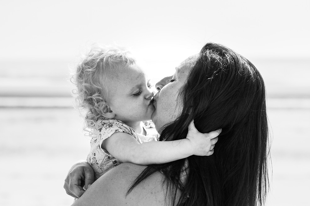 Best-aberdeen-family-children-photographer-montrose-arbroath-outdoor-st-cyrus-beach-mother-kissing-daughter-black-and-white