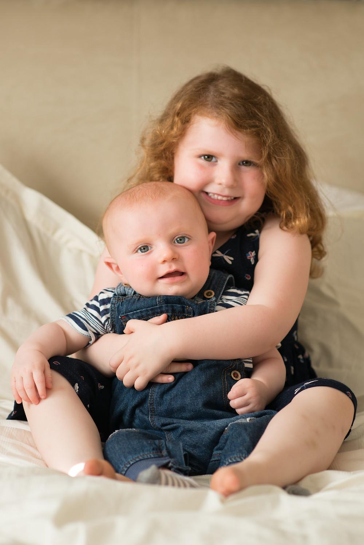 Best-aberdeen-family-children-photographer-montrose-arbroath-aberdeenshire-indoors-natural-light-girl-cuddling-baby