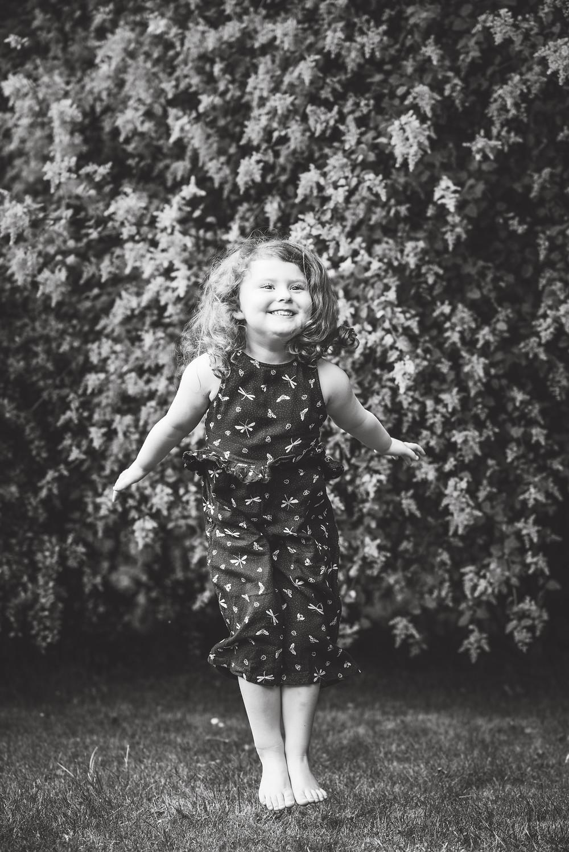 Best-aberdeen-family-children-photographer-montrose-arbroath-aberdeenshire-outdoors-natural-light-black-and-white-girl-jumping