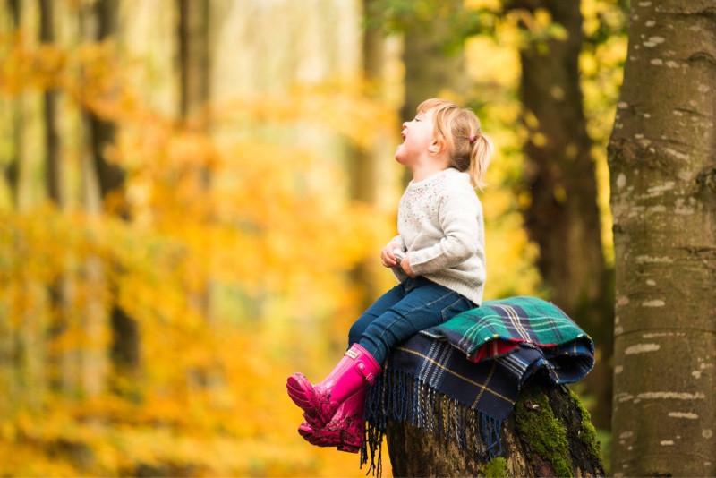 best-aberdeen-family-children-photographer-stonehaven-girl-laughing-in-dunnottar-woods