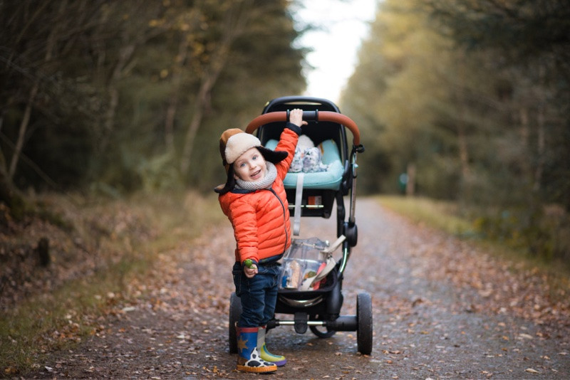 best-aberdeen-family-children-photographer-montrose-boy-pushing-baby-in-buggy-denlethen-woods