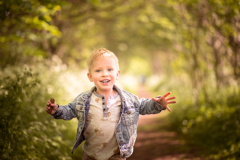 Best-aberdeen-family-children-photographer-montrose-arbroath-aberdeenshire-woodland-boy-running-backlight-85mm-lens