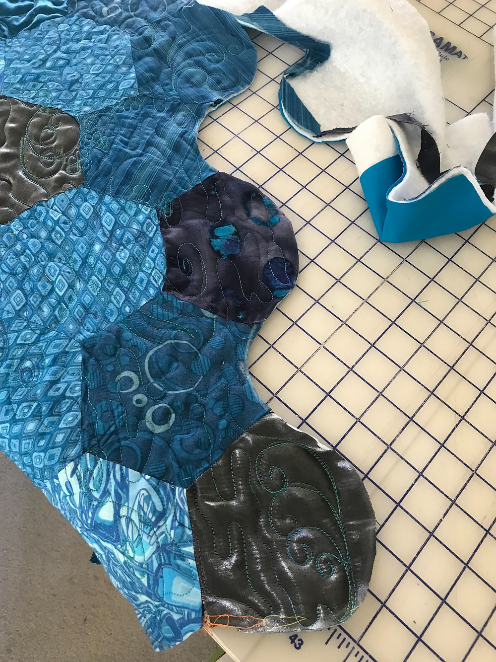 Cutting Border of Koi Pond Machine Quilted by Sally Terry