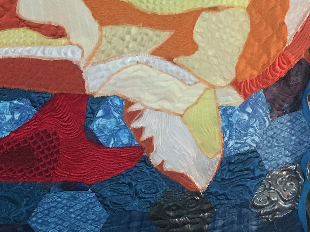 Koi Pond Quilt showing clothing fabrics Machine Quilted by Sally Terry