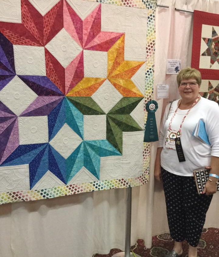 Could not be more thrilled for Ann Sowell-Sarles for another ribbon...thanks for letting me quilt this gorgeous star...Congratulations.