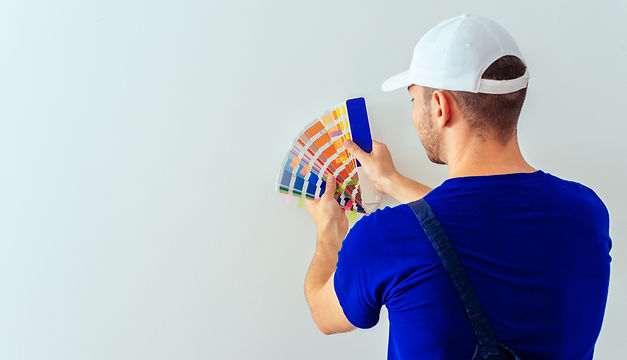Young painter with color guide in his ha